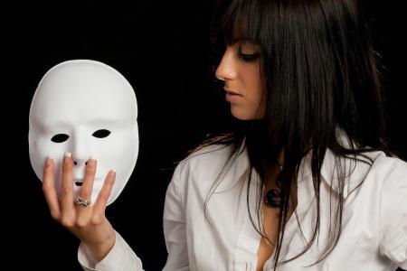 beautiful woman staring at a white mask